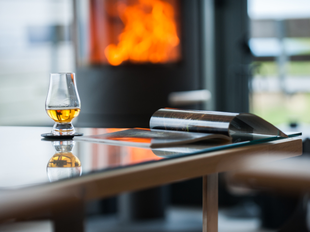The Two Byres, self-catering on Isle of Skye, whisky in front of the fire