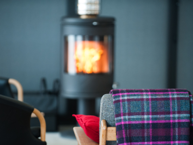 The Two Byres, self-catering on Isle of Skye, cosy in front of the fire